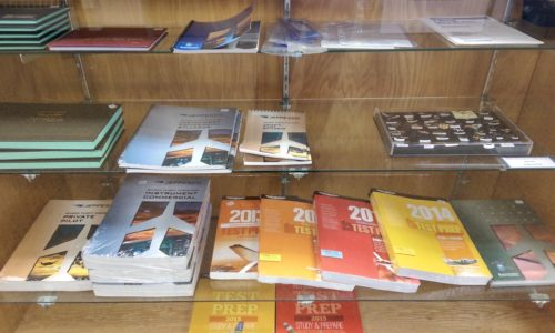A comprehensive display of pilot supplies and books for sale.