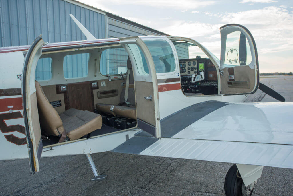 1976 Beechcraft Bonanza with doors open.