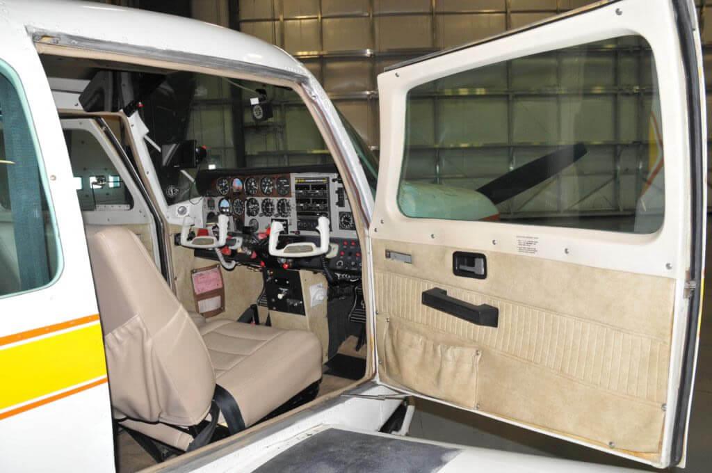 1977 Beechcraft Sundowner with doors open.